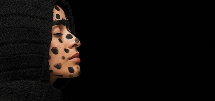 woman-with-black-dots-on-face-1436006-min-min